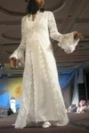 Wedding dress: Beaded lace with satin slip dress underneath. Flounce sleeves and raised collar