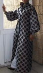 Evening wear: Floor length Coat Dress with puffed sleeves and high collar. Worn here with pants. Fabric: imprinted/textured tafetta